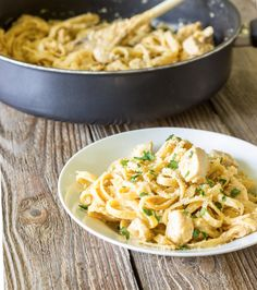 One Pot Wonder Cajun Chicken Alfredo / •2 tbsp. olive oil •1 lb. boneless skinless chicken breast, cut into bite size chunks •2 tsp. Cajun seasoning (I used Weber N'Orleans Cajun) •6 garlic cloves, minced •1 ½ cups chicken broth •1 cup milk (I used 2%) •8 oz. dried fettuccini pasta (half of a 1 pound box) •⅓ cup grated parmesan cheese