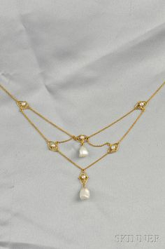 Art Nouveau 14kt Gold and Baroque Freshwater Pearl Necklace, the two freshwater pearl drops joined by delicate trace link chain and navette-form links, lg. 12 1/8 in.