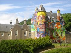 WHY???   Kelburn Castle is a large house in Scotland.   It is the seat of the Earl of Glasgow. Originally built in the thirteenth century it was remodelled in the sixteenth century.  In 2007, after experts told the owners that the concrete facing would eventually need to be replaced to avoid further damage to the stone walls, the Earl invited graffiti artists to paint the walls