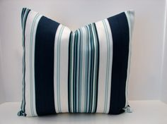 Set of two blue, aqua, green, navy mosaic print , striped designer outdoor indoor fabric- decorative pillow cover-throw pillow-accent pillow. $35.00, via Etsy.