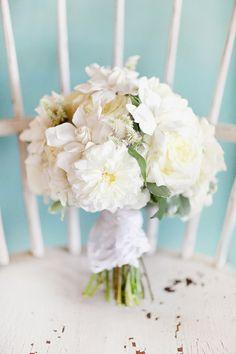 classic all-white bouquet, photo by Simply Bloom http://ruffledblog.com/romantic-alabama-wedding #flowers #white #wedding