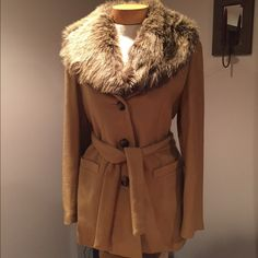 """w/o tags Express tan faux fur collar coat.  without tags Express tan faux fur collar coat. 30"""" long. 3 buttons and belt. Extra button included. Size 9/10. Wool/nylon with poly lining Express Jackets & Coats"""