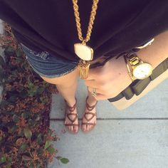 Casual outfit with a boyfriend tank, jean shorts and this amazing cross body bag found at TJ's by @topknotsandpearls!