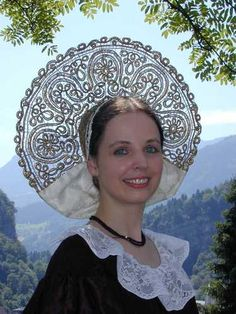 Traditional costume of Feldkirch, Austria - I can't guarantee that this is quilling but it sure appears to be!