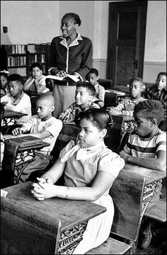 Linda Brown, third grader, the plaintiff in Brown v. Board of Education. She had to walk far past the white school to get to the poorly-funded Negro school.