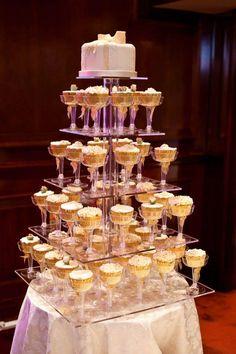 Wedding Cake & Cupcakes. Like this display!