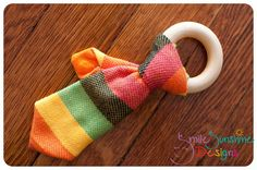 Wrap Scrap Teething Tie -- that's friggin adorable