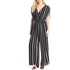 Women's Band Of Gypsies Stripe Surplice Jumpsuit (1.045.435 IDR) ❤ liked on Polyvore featuring jumpsuits, wide leg jumpsuit, sleeved jumpsuit, striped jumpsuit, band of gypsies and jump suit