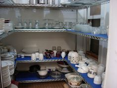 Fully stocked dish pantry in our commercial kitchen for guest use. Glassware, flatware, mugs, plates, bowls, serving dishes, coffee carafs, baking dishes...you name it, it's here, from appetizer plates to ramikens to salad tongs and more @ http://CrystalwoodLodge.com by Crystalwood Lodge, via Flickr