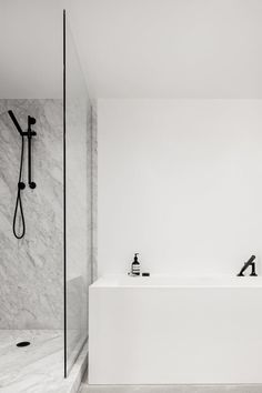 A cross between a hotel room and loft apartment, the space required a simple yet warm design treatment that would suit its diverse occupants. The Saint-Laurent apartment is located in Mon. Minimalist Bathroom, Minimalist Decor, Modern Bathroom, Small Bathroom, White Bathrooms, Minimalist Design, Relaxing Bathroom, Bathroom Showers, Bath Shower