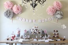 Pink and Grey is just a classic theme. Adding bird nests and cute cupcake holders sets this dessert display table off.