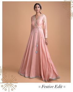 Presenting the best of festive look in crayon colour, which is reinterpreted in vintage-inspired ways. This fit and flare 'Angrakha' silhouette is complemented by the fresh rose pink hue and statement embroidery. The side-tie gives a mod Indian Gowns Dresses, Indian Fashion Dresses, Indian Designer Outfits, Pakistani Dresses, Indian Outfits, Designer Dresses, Silk Kurti Designs, Kurti Designs Party Wear, Stylish Dress Designs