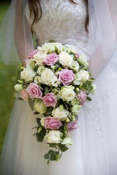 Cascade bouquet of roses, freesia and lisianthus in pink and ivory
