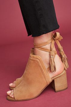 Laces with fringes, peep-toe, and a nice solid heel. I love these tan booties + sandals!