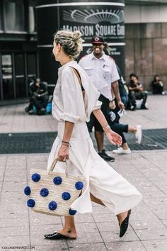 $55 Cute Beach Inspired Summer Beige Straw Bag With Blue PomPom Detail And All White Outfit Open Back Blouse And Midi Skirt Spring Street Style