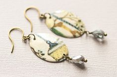 Earthy Drop Earrings by Musing Tree Studios $14.99 #vintagetin #handmadejewelry  You are a free spirited woman who feels at home in nature. Express your unique style with these earthy drop earrings.   They were handmade with vintage tin with a cream and blue design and finished off with dusty blue faceted drop beads and antique brass ear wires.