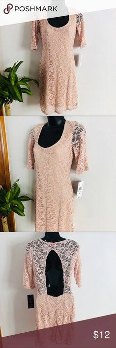 """Blush pink lace dress semi-open back, half sleeves Blush pink lace dress with attached slip. Semi open back with one button closure at neckline. 1/2 length sleeves. Dress is about at the knee for an average height woman (around 5'4""""). NWT. Size Medium.  55% Nylon, 40% Polyester, 5% Spandex.  Measurements (approx): Pit to Pit: 16.5."""" Front scoop neckline about 8.5"""" deep. Sleeve from shoulder seam to cuff: 12.5."""" Length of dress top to bottom: 35."""" Waist width: 14."""" BUNDLE SPECIAL: 15% off 3…"""