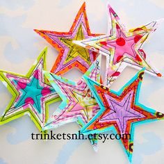 Fabric stars. Love. Love. Love.  Easy DIY and endless possibilities!  Fun as a banner or mobile.