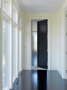 Black interior doors and floor to ceiling windows