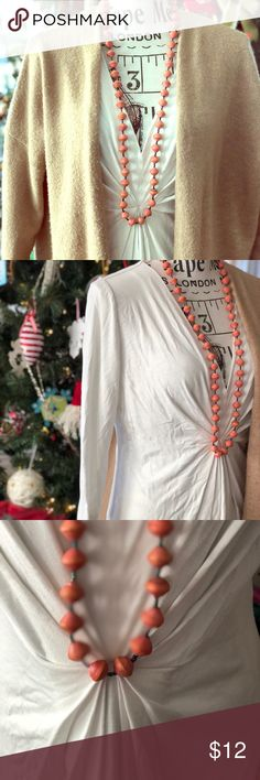 White Fitted Tunic ¾ Length Sleeve This is a Rayon and Spandex so it's light and stretchy. Great for layering. It falls well below the waist. Gathers at the waist and has a low v-neck. New York & Company Tops Tunics
