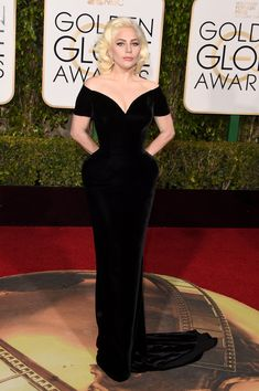 Lady Gaga in a slim navy dress at Golden Globes 2016 red carpet