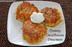 Cheesy Cauliflower Pancakes - swap out bread crumbs for pork rind crumbs (my mom's idea for a carb free crust on fried foods) for even fewer carbs.