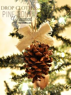 Make a simple Pine Cone Ornament using just pine cones and drop cloth! Perfect for your Rustic Decor