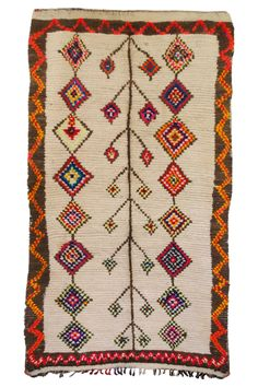 Vintage Moroccan Azilal Rug multi-color wool hand knotted pattern from the M.Montague Souk home goods hand-picked by Maryam Montague