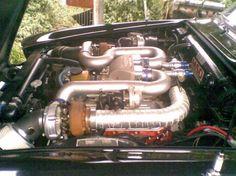 Twin turbo 454 wedged into the engine bay of a Jaguar Mk 10 sedan.