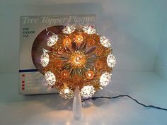 Center tinsel starburst with a light in the middle. First Ring of Orange Lights blink. Two circles of lights-Orange reflectors with orange lights and Gold Reflectors with orange lights. 1 orange Reflector plastic is missing - 1 bulb is has the plastic gold reflector melted to it,but works fine. | eBay!