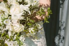 http://www.vervainflowers.co.uk/blue-tin-blossom/  Spring blossom with homegrown tulips and delicate white spring flowers.  Flowers & Design by India Hurst // Vervain Photographs by India Hobson Dress by Velvet Johnstone  #blossom #springflowers #flowers #floristry #floral #wedding #weddingflowers #bridal #bridalbouquet #bouquet #unusualflowers #white #spring #bride #floristry #vervain #vervainflowers