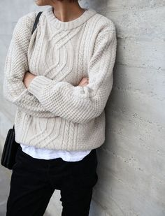 To create an outfit for lunch with friends at the weekend try teaming a beige cable sweater with black jeans.   Shop this look on Lookastic: https://lookastic.com/women/looks/beige-cable-sweater-black-jeans-black-leather-crossbody-bag/7312   — Black Jeans  — Black Leather Crossbody Bag  — Beige Cable Sweater
