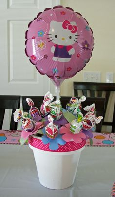 Lollipop centerpiece --- Cute idea and you   can do with whatever the theme is.