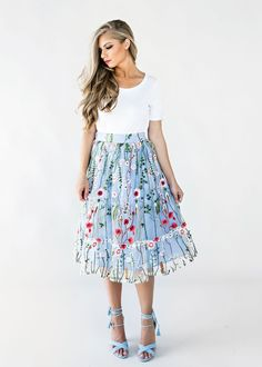 """Summer in Paris Skirt  This skirt has a blue slip lining that is topped off with delicately floral embroidered tool. The linear floral design will lengthen your legs and draw focus to one of the best parts of your figure. To top it all off, the elastic waist is ridiculously comfortable, so while you are out dropping jaws and turning heads you will be absolutely comfortable. Lining: 100% Length: 27"""" $76"""