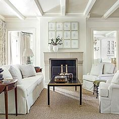 Don't wish to decorate all in white....just like some of the design ideas....the arrangement above the fireplace.