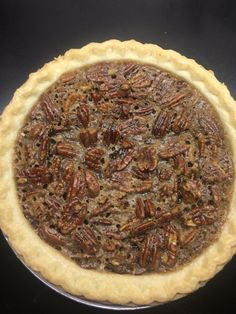 High Altitude Homemade Karo Pecan Pie  3 tablespoons butter 1 cup Karo corn syrup 2/3 brown sugar 2 teaspoons vanilla 3 eggs 1-1&1/2 cups pecans Pie crust   Melt butter Karo syrup and brown sugar in pot on medium. Add vanilla and beaten eggs and remove from heat. Add pecans to mixture and pour into pie crust. Bake at 325 degrees for 40 minutes. When the center springs back to the touch it's ready!