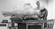 Henry Moore in his studio working on a plaster sculpture