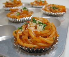 """""""I froze leftover spaghetti in foil liners set in mini muffin tins. Once they were frozen through a couple of hours later, I put them in shallow tupperware for longer-term storage... In the morning, I just put a frozen-solid pasta cup into the bento, and it's totally thawed a few hours later when we're ready to eat. If I were going to microwave them I'd have used paper cups instead of foil."""""""