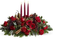 Christmas Flower Arrangements | Christmas arrangement with fruits and red candle / Fair Hill Florist