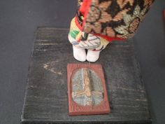 A fumi-e was a religious icon used test to the faith of Japanese  Christians. It could be made out of bronze, wood, or ceramic, or a combination of  materials. Some would feature the Madonna, but in this example we see that this fumi-e is a crucifix.