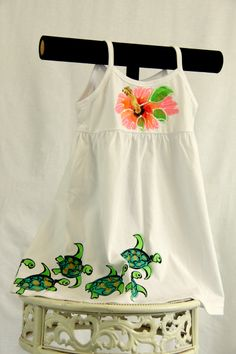 This little girls cotton dress is hand painted.  It comes in sizes 18 months to size 8.  The sea turtles swim from back to front searching for the hibiscus.  Details - email Nancy at winstonmauiarts@gmail.com