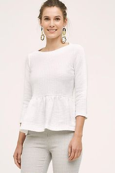 Love this white peplum top under $30. Amadi Ruffled Peplum Pullover