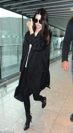 Travelling in style: Kendall Jenner looked chic in a simple black ensemble upon arriving a...