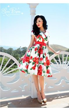 Birdie Party Dress in Red Vintage FloralThe Birdie Dress is a full skirted, vintage-style party dress with a wide, notched collar creating a classic, polished silhouette. Finished off with a side zipper and wide red vinyl belt. In white sateen with Pinup Couture's exclusive red vintage floral print, this dress is a real head-turner! - See more at: http://www.pinupgirlclothing.com/birdie-dress-red-vintage-floral.html#sthash.VWm44dhN.dpuf