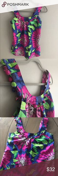 Lilly Pulitzer silk tank shirt cami tassel ball So cute for summer! Lilly Pulitzer size 0 tank top. 100% silk. Fun ball accent in matching fabric around collar and shoulder straps. Smoke free pet free home. Measures approx 15 inches across pit to pit and 24 inches length. Lilly Pulitzer Tops Tank Tops