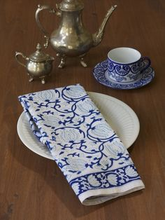 Blue and White Floral Party DINNER NAPKINS: Paying homage to the magnificent lotus flower, the napkins will bring to your dining table the same ethereal, graceful beauty. Accessorize this print with cobalt blue dinnerware for striking effect, or pristine white for a fresh clean approach. Rattan or silver chargers, blue tinted glassware and white floral centerpieces will enchant and delight the senses.