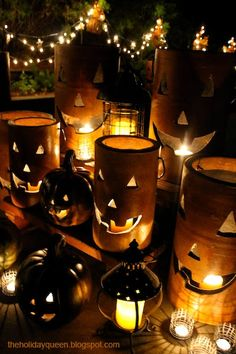 We so impressed with how artist Melissa Valeriote used those Home Depot pottery jack-o-lanterns in her bewitching outdoor Halloween decor.