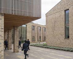 City of London Freemen's School / Hawkins\Brown, light brick masonry, vertical wood sunshades, wood ceiling, kids Brick Architecture, Education Architecture, School Architecture, City Of London, Light Brick, Brick Masonry, Brick Art, Timber Buildings, Timber Cladding
