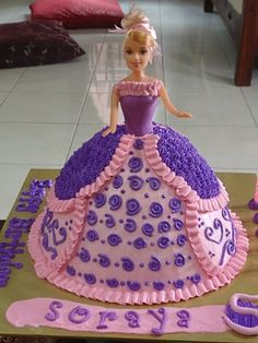 purple and pink doll cake