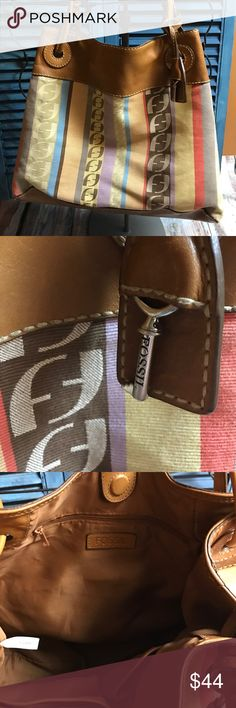 """Excellent condition Fossil purse In good excellent used condition Fossil purse multi color great with any season. Size without straps 18""""X 11""""X8"""" this is a bigger Fossil purse. Fossil Bags Hobos"""